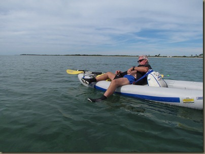 al putting on wetsuit in kayak