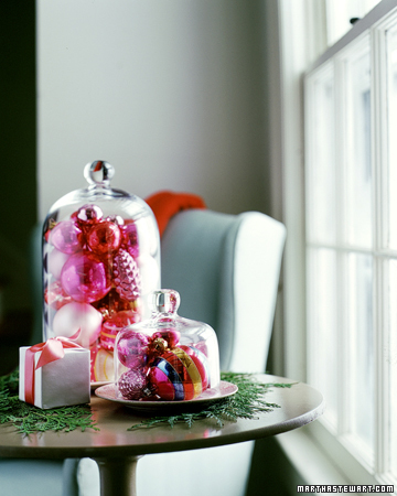 Filled with sparkly trimmings, these garden cloches add radiance to any tabletop.