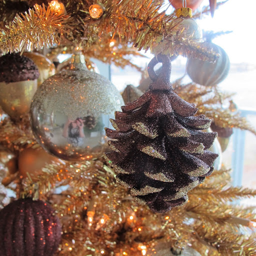 A close-up photo of a glittered pinecone ornament.