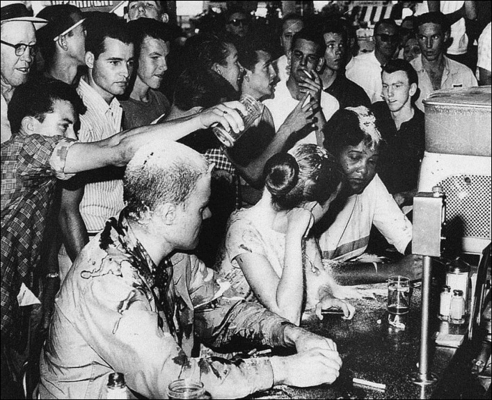 Lunch Counter Sit-In. Jackson Mississippi 1963 - Civil Rights demonstrators being taunted and covered with sugar mustard and ketchup.