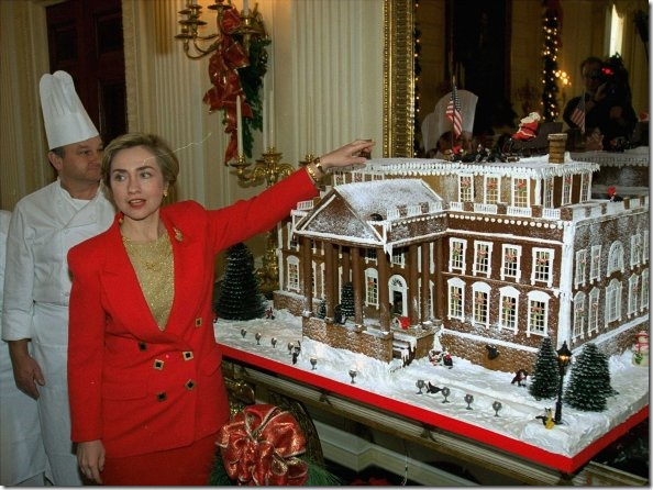 first-lady-hillary-clinton-gestures-to-a-massive-gingerbread-house-in-1993 (1)