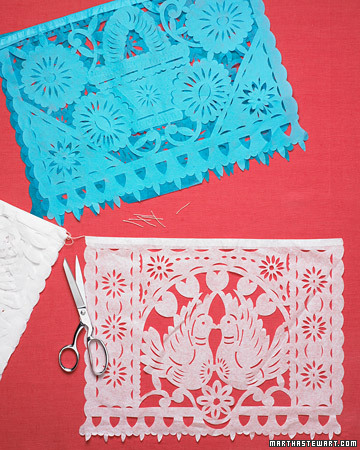 You can find these colorful paper flags at craft stores. Cut them apart for easy, festive placemats. (marthastewart.com)