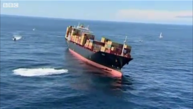 Cargo ship The Rena aground on the Astrolabe Reef, off the port of Tauranga, 11 October 2011. BBC