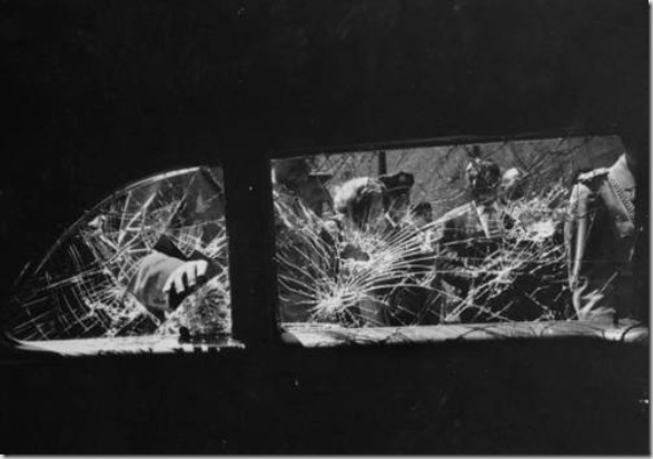 Demonstrators shattering the windows on Vice President Richard M. Nixon's car during his tour of South America.