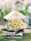 A mini greenhouse within a greenhouse: This peaked box holds orchids and would be a lovely element to include on your escort-card or guest-book table.