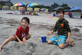 Eidan and Kai making a sand castle