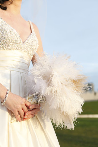 I thought a feather bouquet would be a great keepsake. Every time I see it on my dresser, it's an instant pick me up.