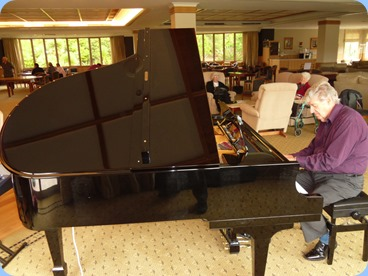 Ian Jackson playing the grand piano during lunch break.