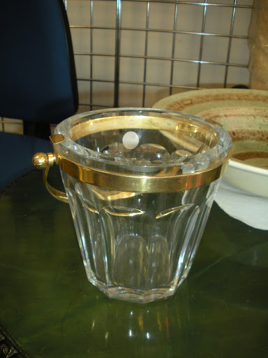 The classic gilded edge is so sophisticated on this pail. It would make the perfect addition to a home bar.