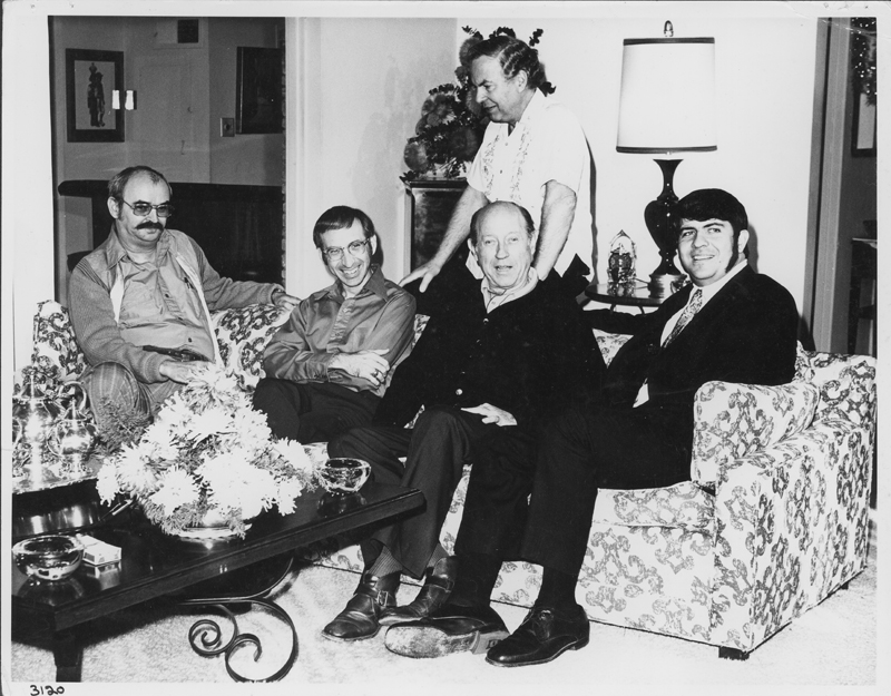"A gathering of some of the people in Pat Rocco's film ""ONE Adventure."" The people include (from left to right sitting) Jim Kepner, Dick Winters, W. Dorr Legg, and Reverend Troy Perry. 1972."