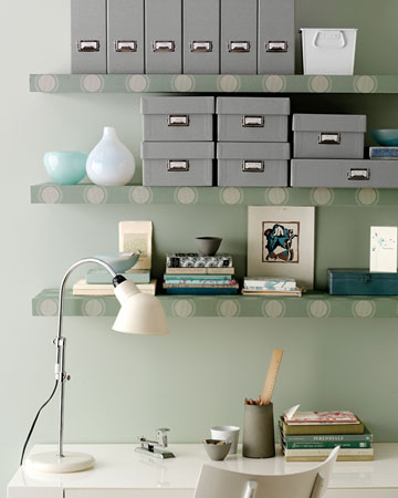 Add a splash of personality to a lackluster work space by covering plain floating bookshelves with wallpaper.