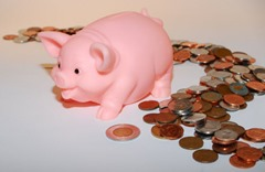 piggy bank with trail of coins