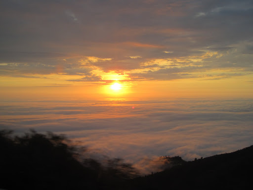 Sunset after breaking through the clouds on the mountains to Cuenca