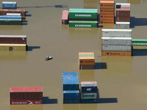 Some stacked shipping containers in Saxony, Germany, on 6 June 2013 remain dry while others become partially submerged as waters from the Elbe River continue to rise. According to the BBC, officials in this German state have warned that the current flooding may exceed record levels from 2002. Photo: Thomas Peter / Reuters