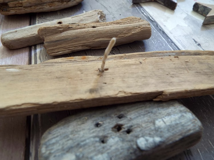 How to make a drift wood and star mobile threading driftwood on to twine