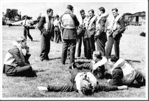 Spitfire pilots of 610 Squadron relax between sorties