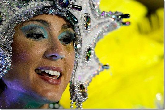 A dancer from the Imperatriz Leopoldinense samba school perfoms at the Sambadrome in Rio de Janeiro. (Felipe Dana/Associated Press)