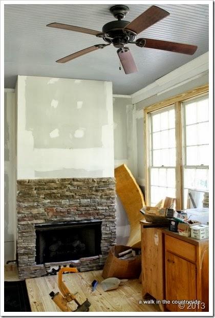 stone fireplace in sunroom
