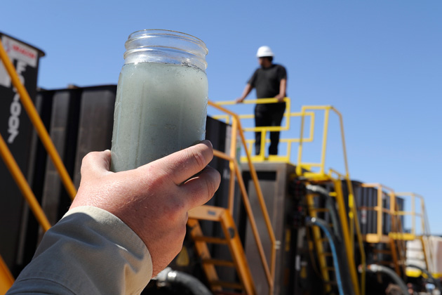 The potential impact of waste from oil and gas drilling — including hydraulic fracturing — on drinking water has been an issue in Texas, Wyoming and, with great urgency, in California this month. Here, a jar of fracking water waste is displayed at a recycling site in Midland, Texas. Photo: Pat Sullivan / AP