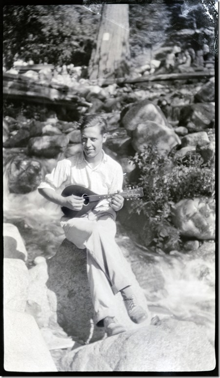 Arthur Iverson playing a mandolin