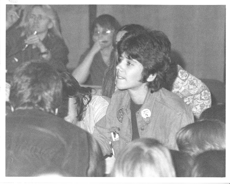 Jeanne Cordova with Sacramento Metropolitan Community Church (MCC) organizer, Reverend Frieda Friedman (rear, far right) and Barbara McLean of the Lesbian Activist Women at a planning meeting for the first national Lesbian Conference. UCLA. February 3, 1973.