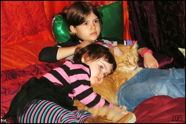 girls cuddling with tigger