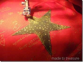 sew the applique to the background fabric