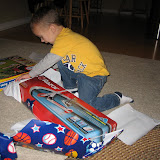 Sam opening his presents 11-3-11 (4).JPG
