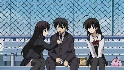 Kotonoha leans in to clean Makoto's face as Sekai watches