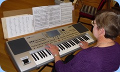 Pam Rea playing her Korg Pa80