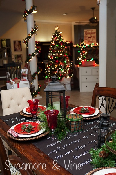 Chalkboard table runner plaid Country Christams inspired Tablescape. A truly stunning Christmas Home Tour as part of the Christmas in the Country Blog Tour. This Plaid Inspired Country Christmas will knock your socks off. Features tours of the Living room, Dining Room and a Cocoa hot chocolate bar in the Breakfast room. There is so much inspiration for Christmas decorations in this one post. Be prepared to feel like you are cuddled up by the fire in a warm Northwoods comfy cottage! #country #Christmas #Plaid #Holiday decorating #Holiday ideas #Holidays #Christmas decor #Holiday decor