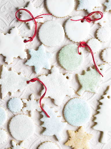 The cookies will be sturdier for hanging if you ice them with the royal icing. Try adding tiny amounts of food coloring to small bowls of the icing to make different colors.