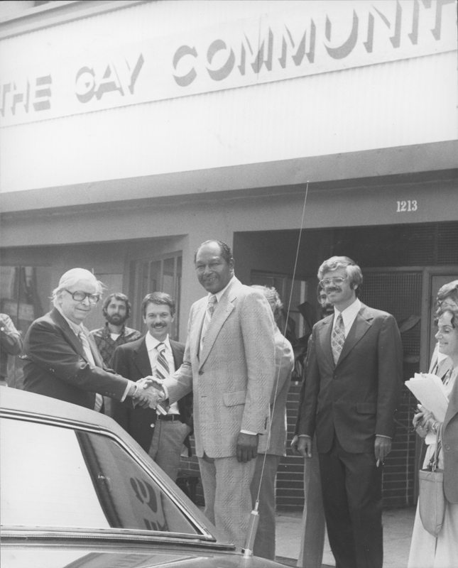 Mayor Tom Bradley is welcomed by Morris Kight (left), Don Amador (center), and Dick Hingson (right) to the Gay Community Services Center. 1978.