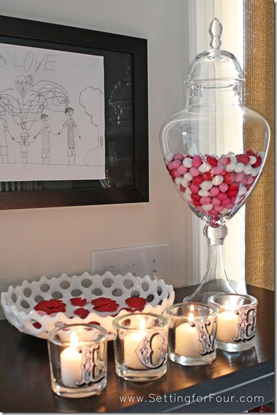 DIY Pottery Barn Inspired Valentine's Day Votives from Setting for Four.  See the tutorial here: http://settingforfour.blogspot.com/2012/01/love-votive-candle-set.html #diy #craft #modpodge #valentine #candle