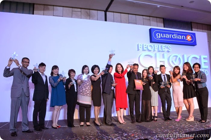 Ms Loi Liang Tok (in red) with winning brands at the Guardian People's Choice Award ceremony