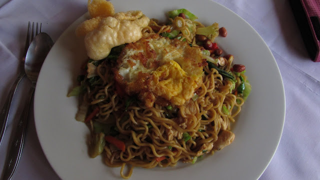 Cheap, delicious Indonesian mie goreng ayam (fried noodles with chicken).