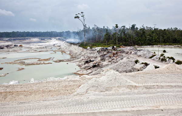 Pools of stagnant water and the cratered landscape of this PT Timah tin mine have replaced forest and farmland. Mobile device giant Samsung has admitted to using tin sourced from the controversial mining operation on the Indonesian island of Bangka, where unregulated mining kills 150 miners a year and causes substantial environmental damage Photo: Ulet Ifansasti