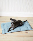 What mutt could not resist a homemade bed? This soft cushion is easy to clean, rolls up for travel and makes use of towels you already have!