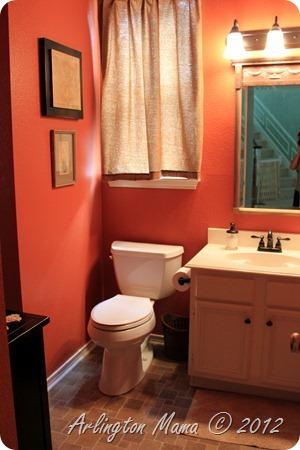 """Guest bathroom reveal"", ""guest bathroom before"", ""guest bathroom remodel"", ""travertine floor in bathroom"", ""orange walls in bathroom"", ""laminate floor in bathroom"""