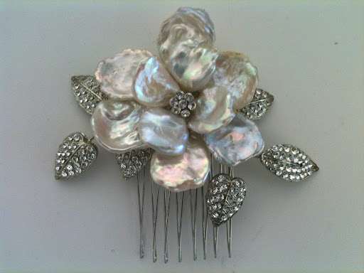 Regina B. has some of the best combs around. This mother of pearl flower one caught my eye.