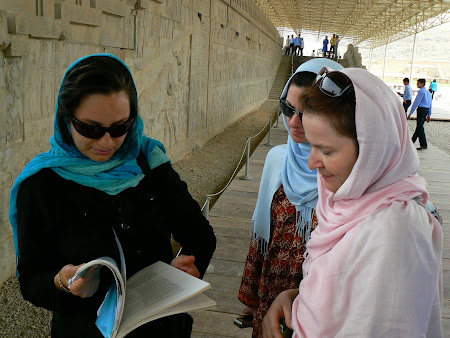 Things to see in Persepolis - guide reading a book