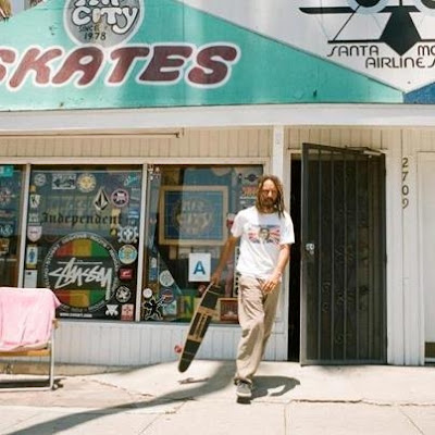 Tony coming out of a skate shop with his re-make 2012 Torger Johnson model.