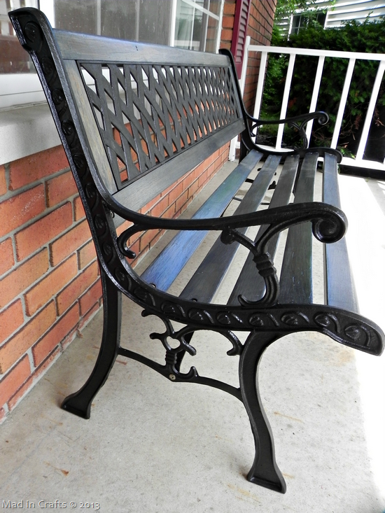 repainted wrought iron bench supports