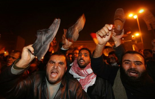 Anti-government protesters rage in Cairo, Egypt, in 2011. A new study from the Center for American Progress makes a persuasive case that interplay between climate change, food prices, and politics is a hidden stressor that helped fuel the Arab Spring revolutions in 2011. Photo: Getty Images