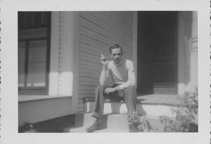 Edgar Sandifer posing on the porch of a house. Circa 1950s.