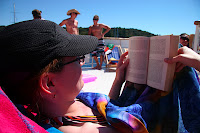 Kristy reading on the boat