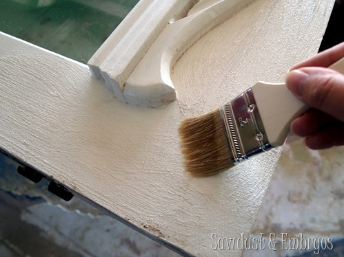 Stripping interior doors begins with applying the stripper with a paint brush.
