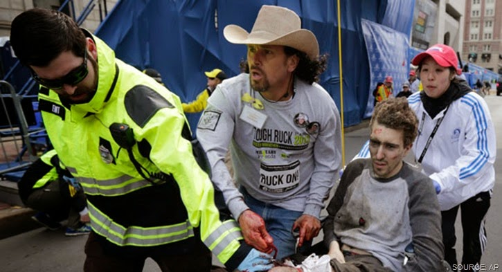 Gravely injured Jeff Bauman rescued by paramedics and everyday hero Carlos Arredondo.