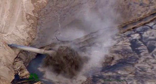 Aerial view of a toxic tailings pond at the Athabasca tar sands mine in Alberta, Canada. Photo: NBC News