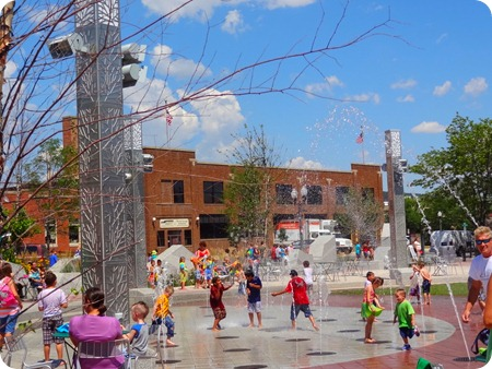 Kids running through fountain.